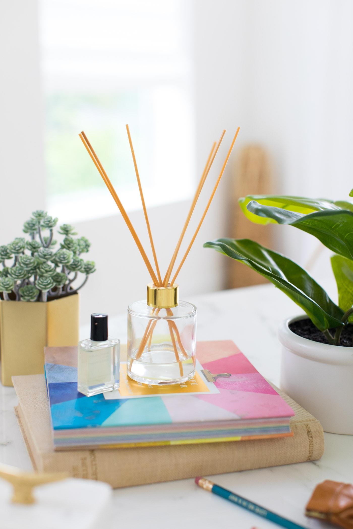 photo of a DIY reed diffuser by top Houston lifestyle blogger Ashley Rose of Sugar & Cloth