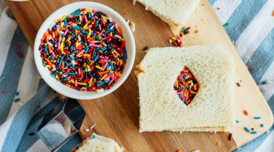 photo of a peanut butter and jelly sandwich version of fairy bread recipe by top Houston lifestyle blogger Ashley Rose of Sugar & Cloth