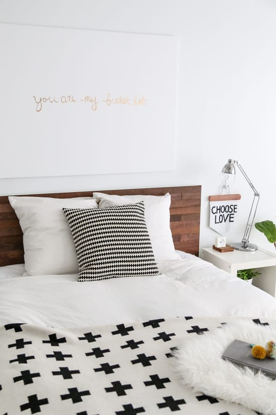 perfect weekend project! Easy Ikea Hack DIY Wooden Headboard With Stikwood by top houston blogger Ashley Rose of Sugar and cloth