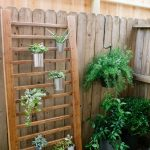 photo of a wooden handrail as a DIY vertical garden
