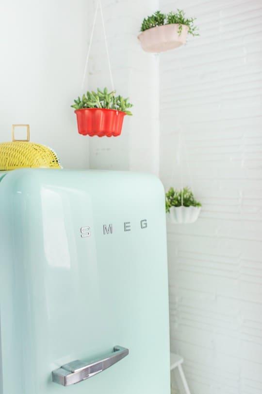DIY hanging bundt cake pan planters | sugarandcloth.com