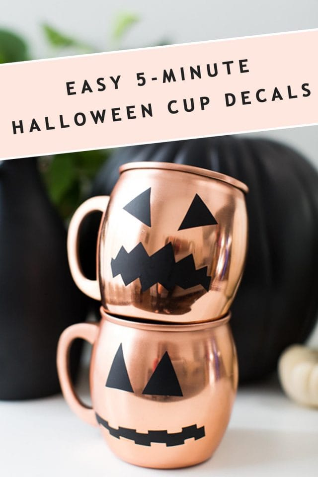 photo of two stacked copper mugs with halloween pumpkin faces