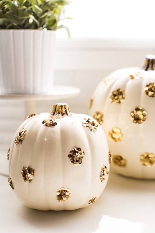 DIY Sequin Polka Dot Pumpkin by top Houston blogger Ashley Rose | sugarandcloth.com #halloween #festive #pumpkin #sequin #fall #thansksgiving #diy #diypumpkin #glam #glamhalloween #homedecor #diydecor #polkadot