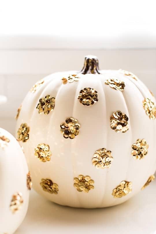 DIY Sequin Polka Dot Pumpkin by top Houston blogger Ashley Rose | sugarandcloth.com #halloween #festive #pumpkin #sequin #fall #thansksgiving #diy #diypumpkin #glam #glamhalloween #homedecor #diydecor #polkadot