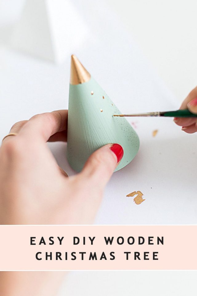photo of painting a tree shaped wooden cone for christmas by sugar and cloth