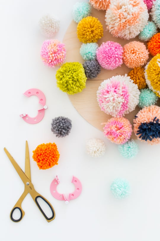 Step 2 -DIY Pom Pom Wall Hanging by Top Lifestyle Blogger Ashley Rose | Sugar & Cloth #DIY #pompom #wallhanging #yarn #yarnpompoms #homedecor #diydecor #colorful #make