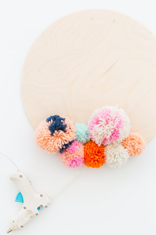 Step 3 -DIY Pom Pom Wall Hanging by Top Lifestyle Blogger Ashley Rose | Sugar & Cloth #DIY #pompom #wallhanging #yarn #yarnpompoms #homedecor #diydecor #colorful #make