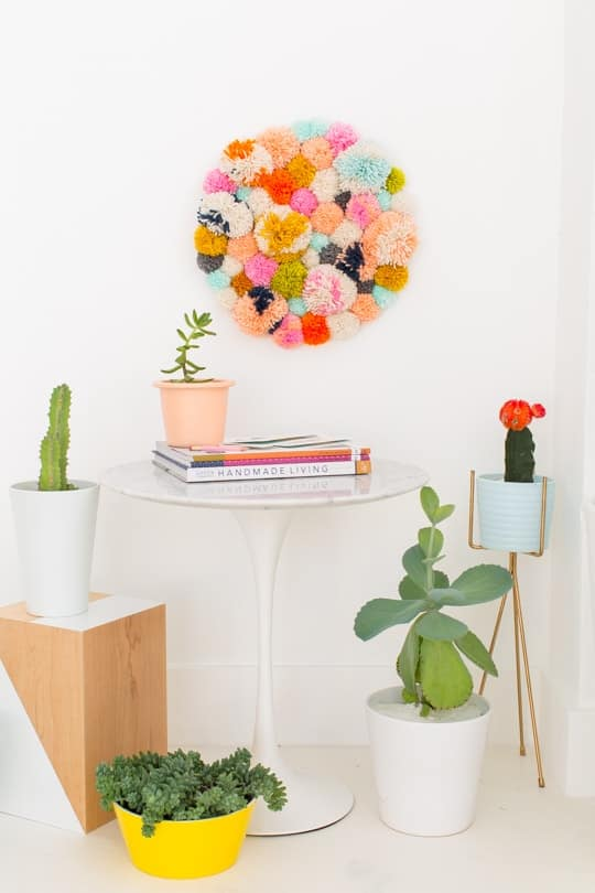 DIY Pom Pom Wall Hanging by Top Lifestyle Blogger Ashley Rose | Sugar & Cloth #DIY #pompom #wallhanging #yarn #yarnpompoms #homedecor #diydecor #colorful #make
