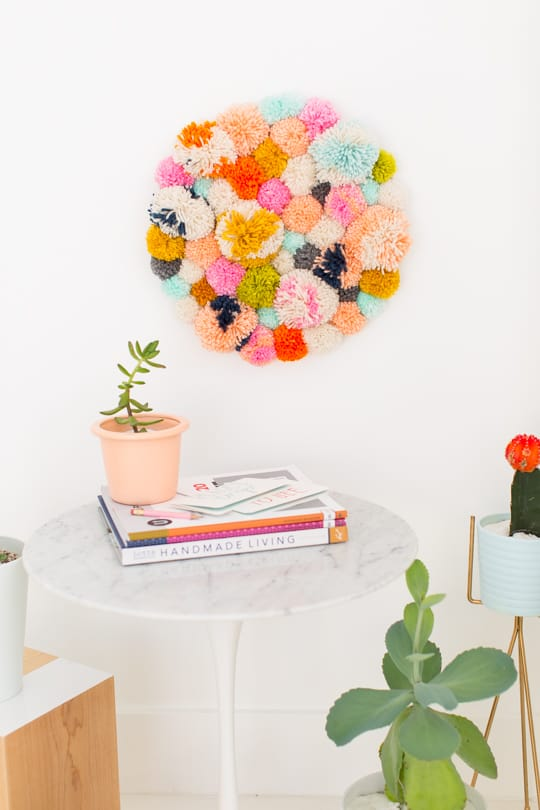Step 6 - DIY Pom Pom Wall Hanging by Top Lifestyle Blogger Ashley Rose | Sugar & Cloth #DIY #pompom #wallhanging #yarn #yarnpompoms #homedecor #diydecor #colorful #make