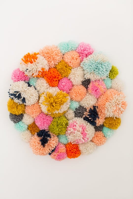 Step 4 - DIY Pom Pom Wall Hanging by Top Lifestyle Blogger Ashley Rose | Sugar & Cloth #DIY #pompom #wallhanging #yarn #yarnpompoms #homedecor #diydecor #colorful #make