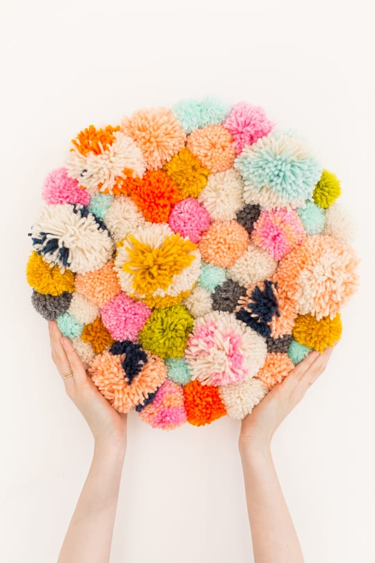 Step 7 -DIY Pom Pom Wall Hanging by Top Lifestyle Blogger Ashley Rose | Sugar & Cloth #DIY #pompom #wallhanging #yarn #yarnpompoms #homedecor #diydecor #colorful #make
