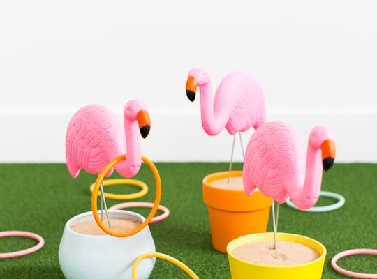 photo of a backyard games idea DIY flamingo ring toss yard game - sugar & cloth