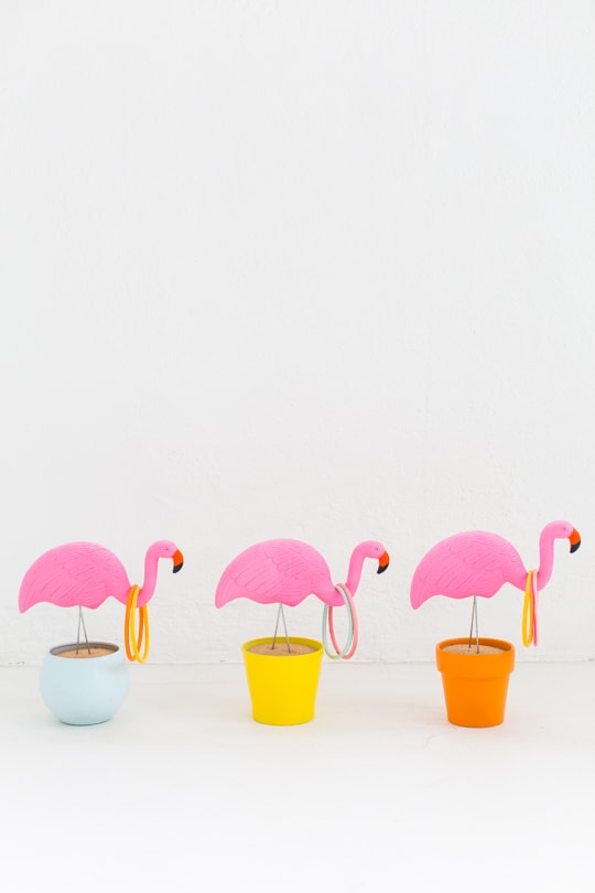 photo of the DIY flamingo ring toss yard game if you don't have a backyard by Ashley Rose of Sugar & Cloth, an award winning DIY and entertaining blog.