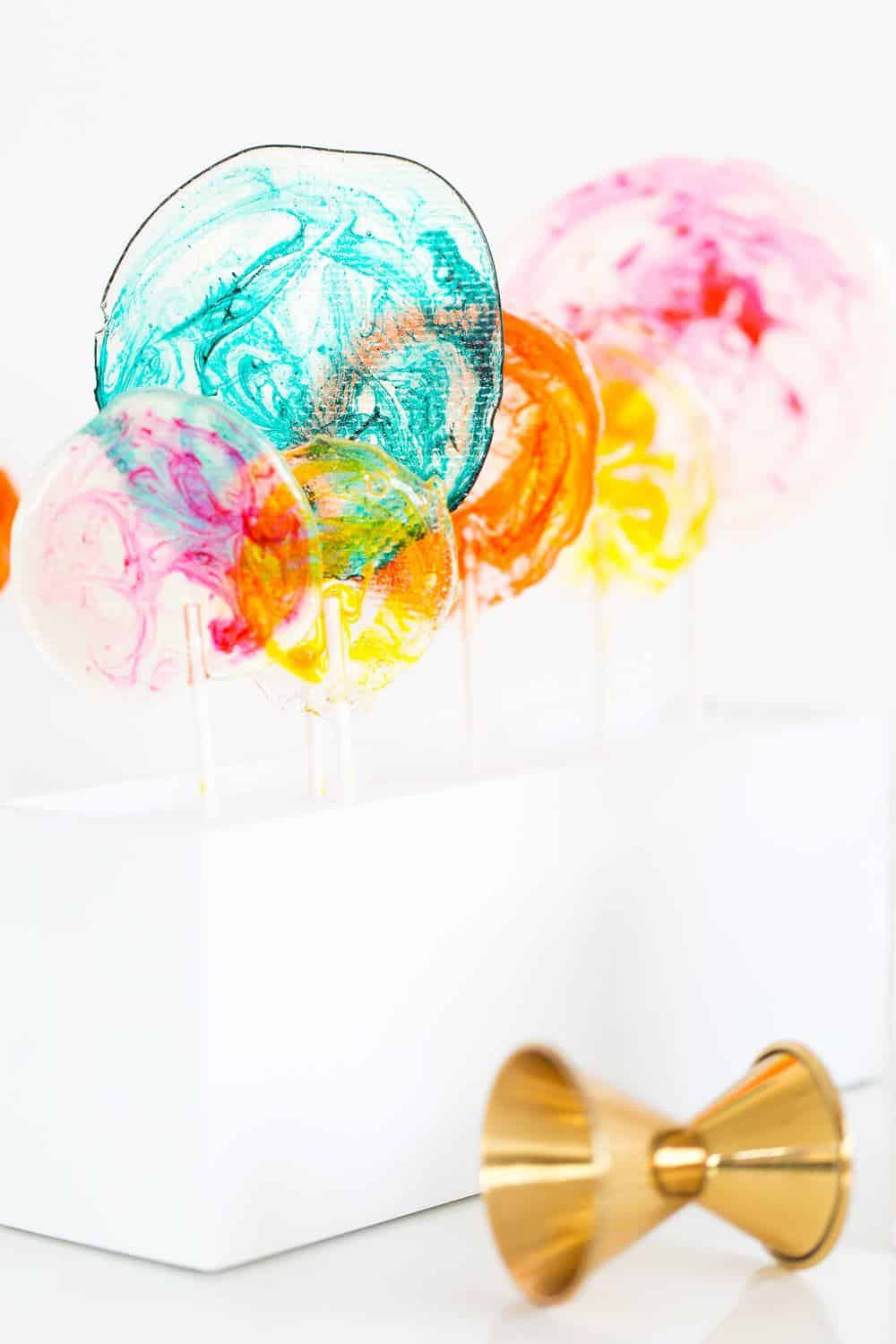 DIY Marble Spiked Lollipops by Sugar & Cloth Top Houston Lifestyle Blogger Ashley Rose #lollipops #diy #recipe #marble #spiked #tequila #alcohol #adult #candy #sweets