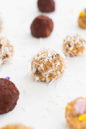 an energy ball with coconut flakes on it