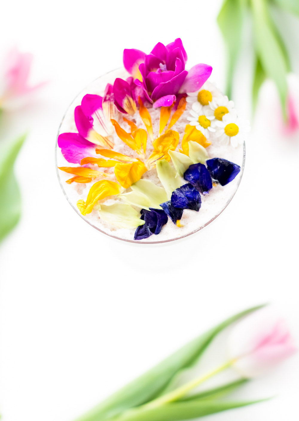 A perfectly Spring edible flower Rainbow Sour cocktail recipe that's almost too pretty to drink! - sugar and cloth