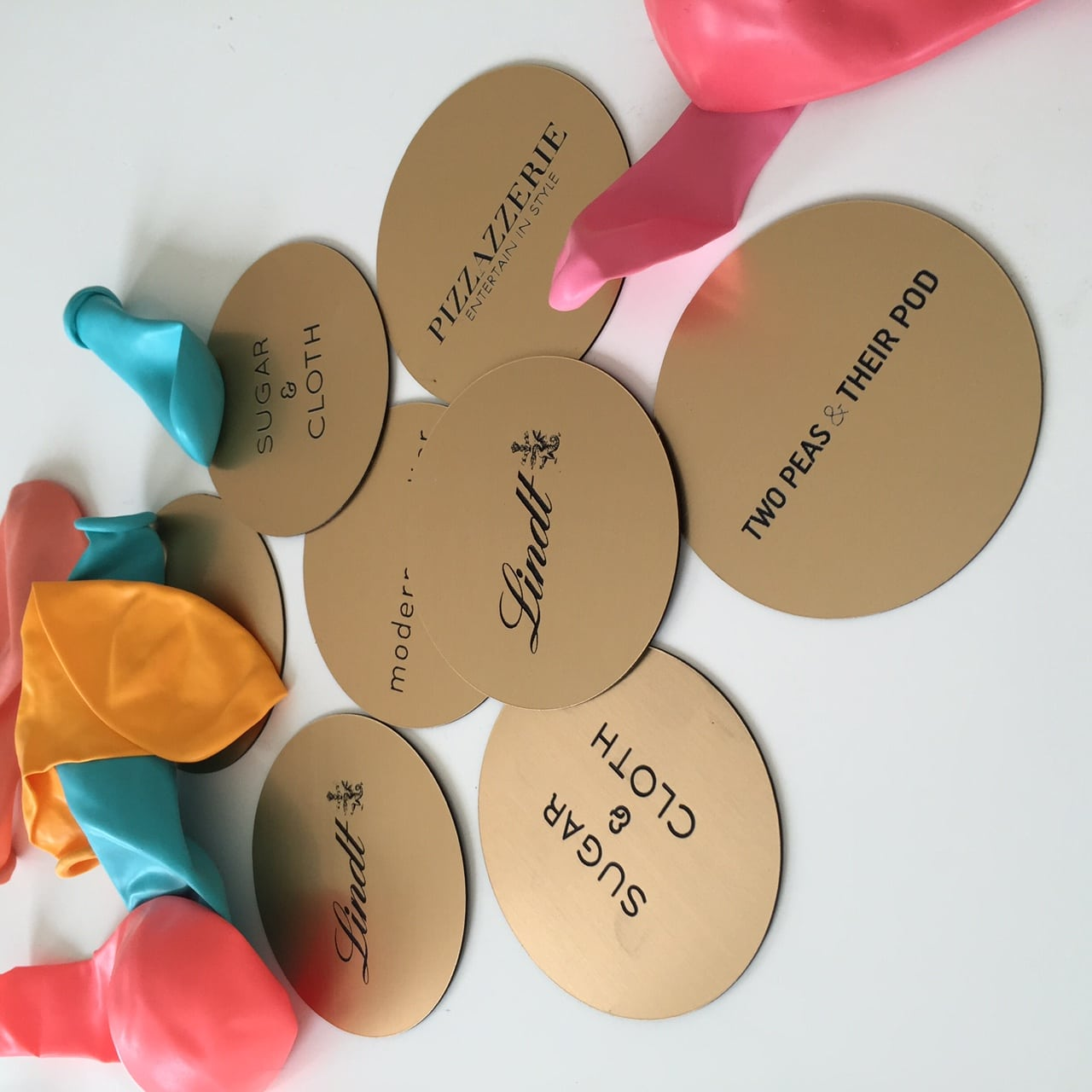 metallic gold place cards that were designed by Sugar & Cloth for Lindt chocolate - ashley rose