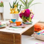 photo of a styled and set dining table with floor seating ideas
