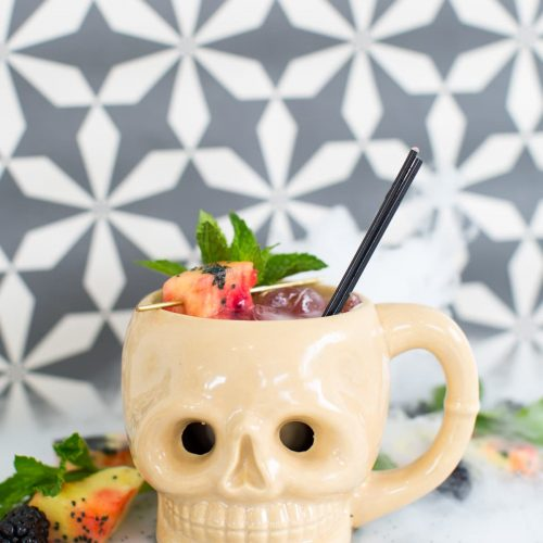 photo of the Halloween drink, the Shrunken Skull Cocktail recipe by top Houston lifestyle blogger Ashley Rose of Sugar & Cloth