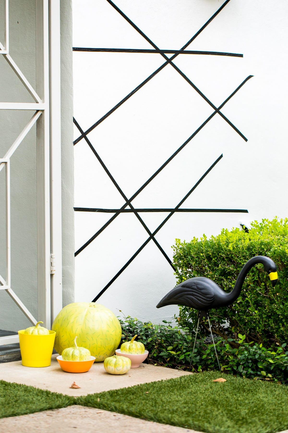 washi tape makes for an easy Palm Springs Inspired Halloween Entryway Decor & Product Round Up by top Houston lifestyle blogger Ashley Rose - #halloweendecor #halloween #decor #home #holidays #curbappeal #palmsprings #midcentury