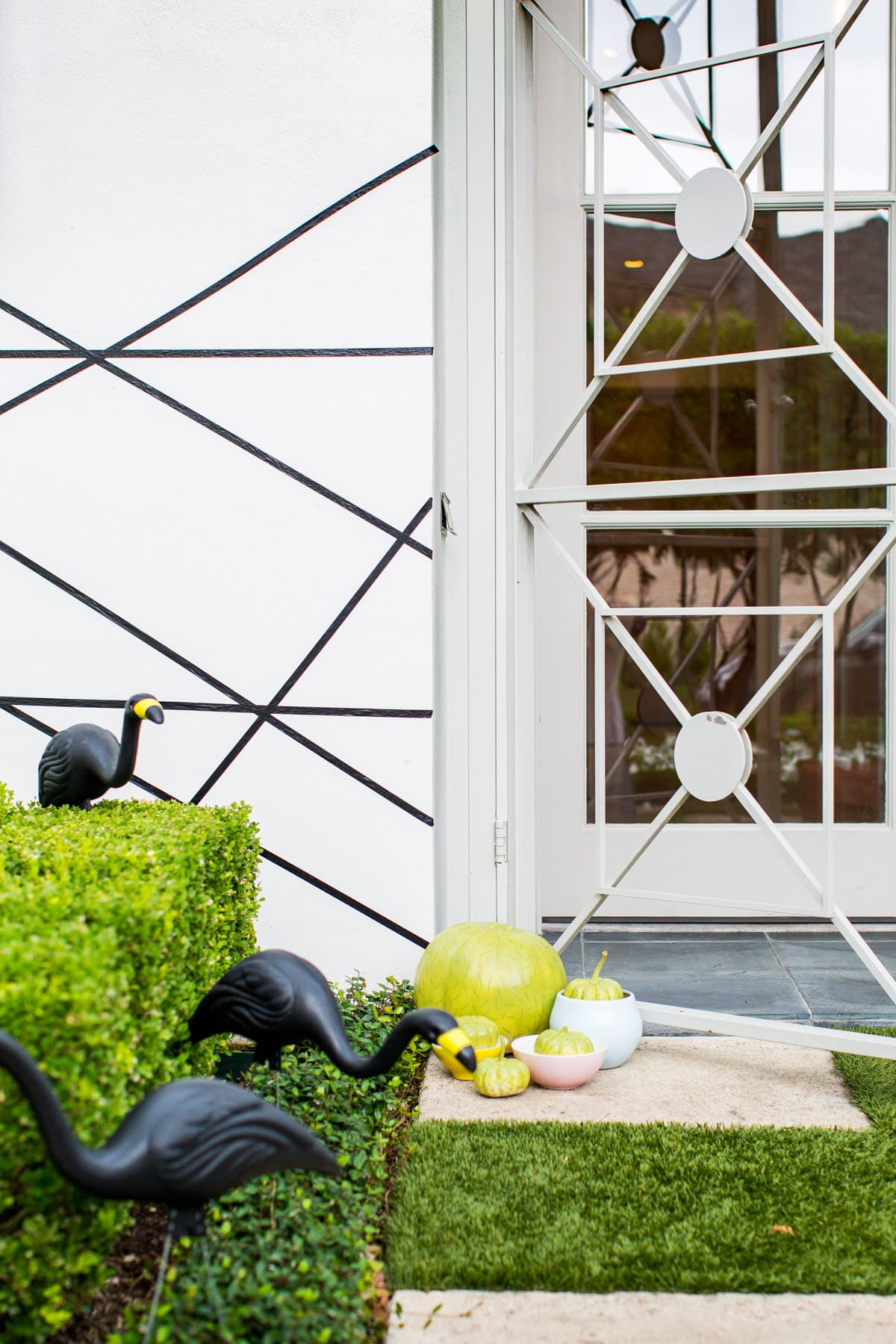 DIY a perfectly spooky geometric entry way - Palm Springs Inspired Halloween Entryway Decor & Product Round Up by top Houston lifestyle blogger Ashley Rose - #halloweendecor #halloween #decor #home #holidays #curbappeal #palmsprings #midcentury