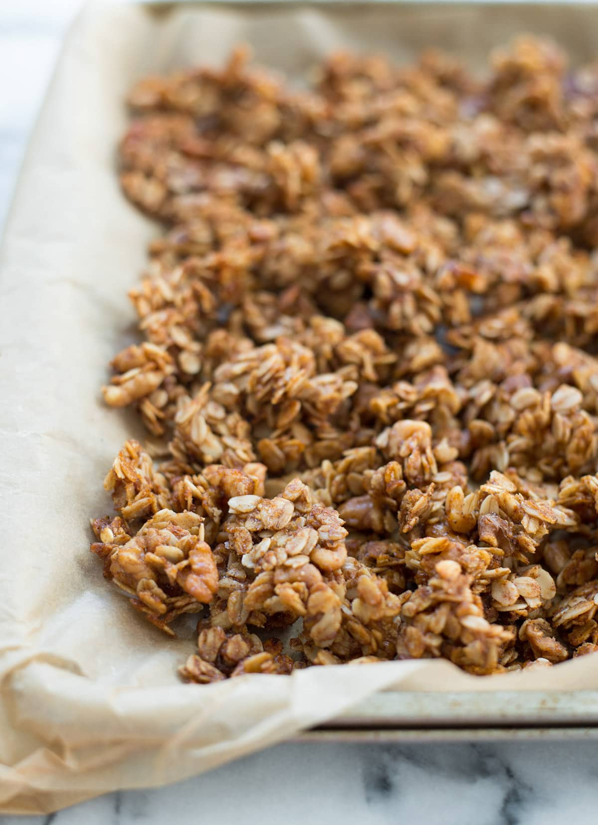 Homemade granola baking.. Healthy Easy Baked Apple Recipe with Spiced Granola and Yogurt - Sugar & Cloth - Houston Blogger - Fall - Recipe