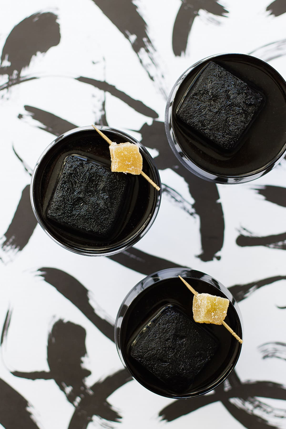 creepy cocktails -- Detoxing Activated Charcoal Cocktail Recipe by top Houston Lifestyle Blogger Ashley Rose of Sugar and Cloth #recipe #cocktail #halloween #detox #charcoal