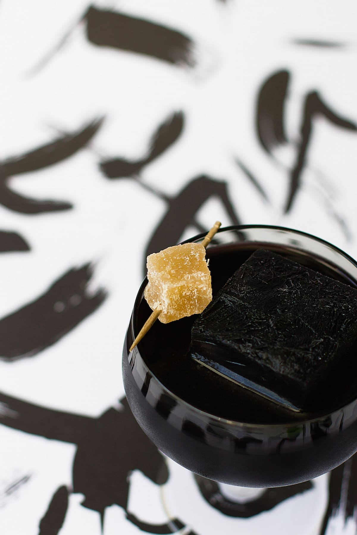 garnished with ginger.. Detoxing Activated Charcoal Cocktail Recipe by top Houston Lifestyle Blogger Ashley Rose of Sugar and Cloth #recipe #cocktail #halloween #detox #charcoal