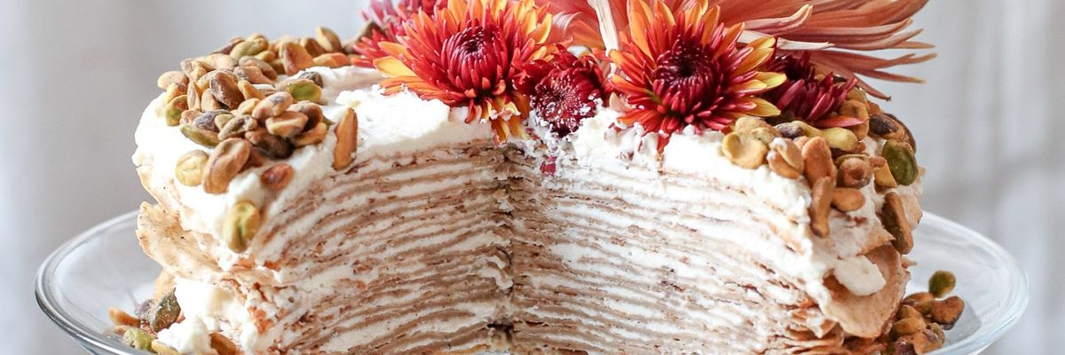 photo of a sliced chai crepe cake recipe by sugar and cloth