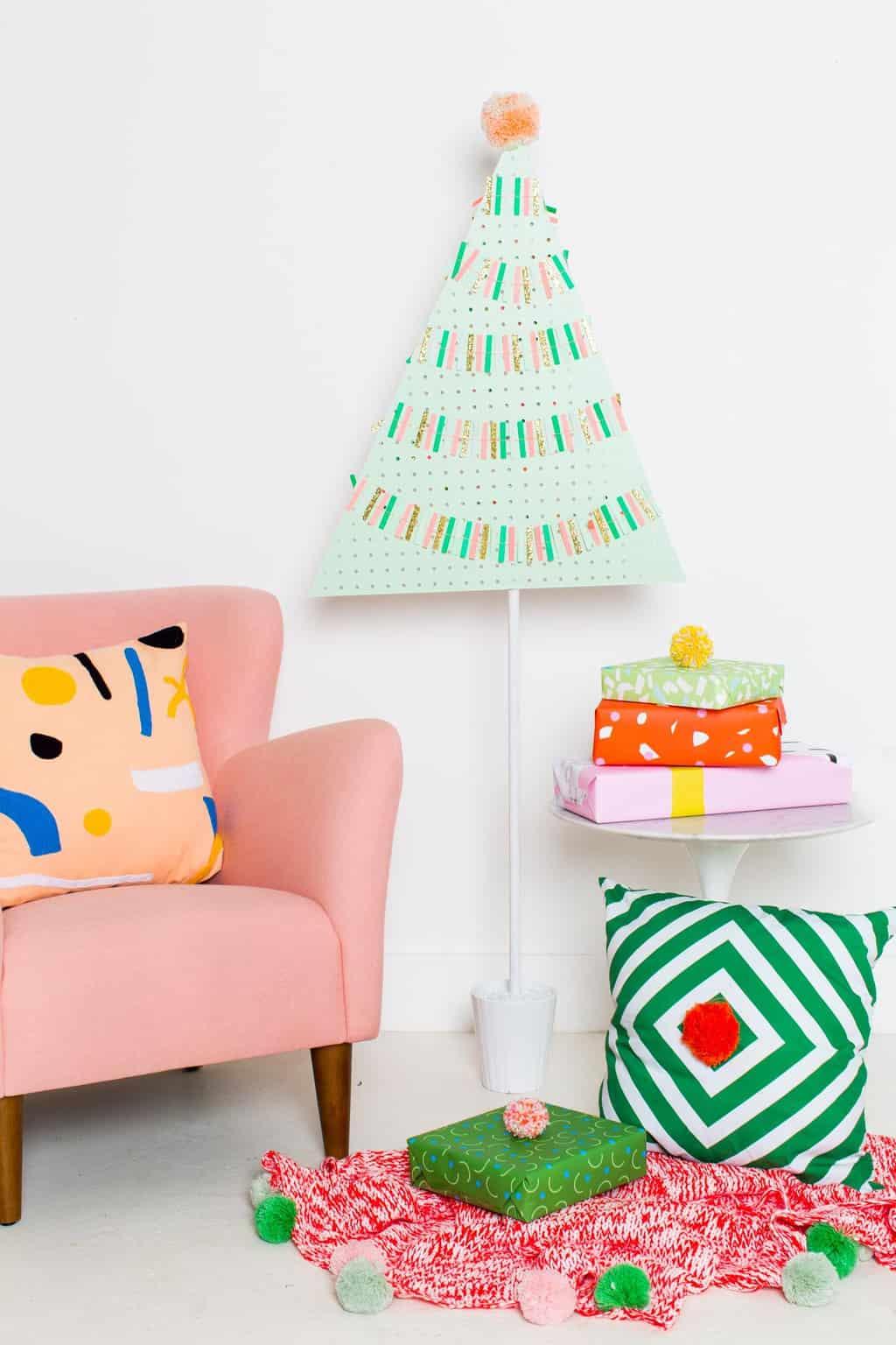 A DIY Pegboard Christmas Tree by DIY Blogger Ashley Rose of Sugar & Cloth