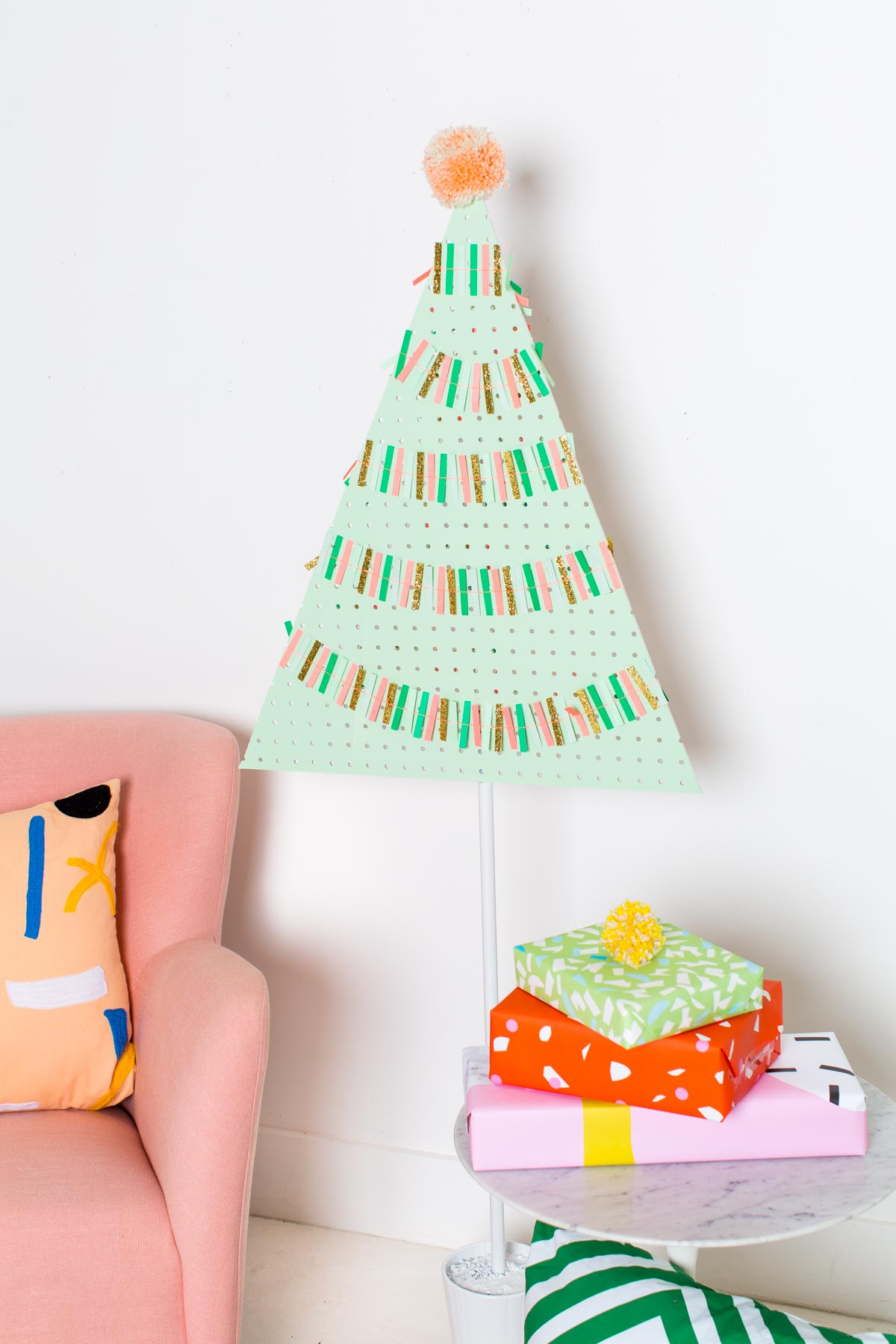 A DIY Pegboard Christmas Tree by DIY Blogger Ashley Rose of Sugar & Cloth