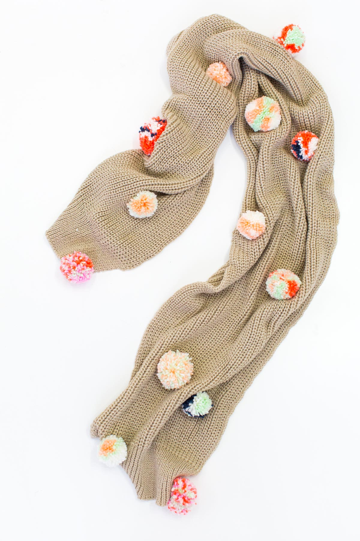 DIY Statement Pom Pom Scarf by Ashley Rose of the award winning DIY and lifestyle blog, Sugar & Cloth.