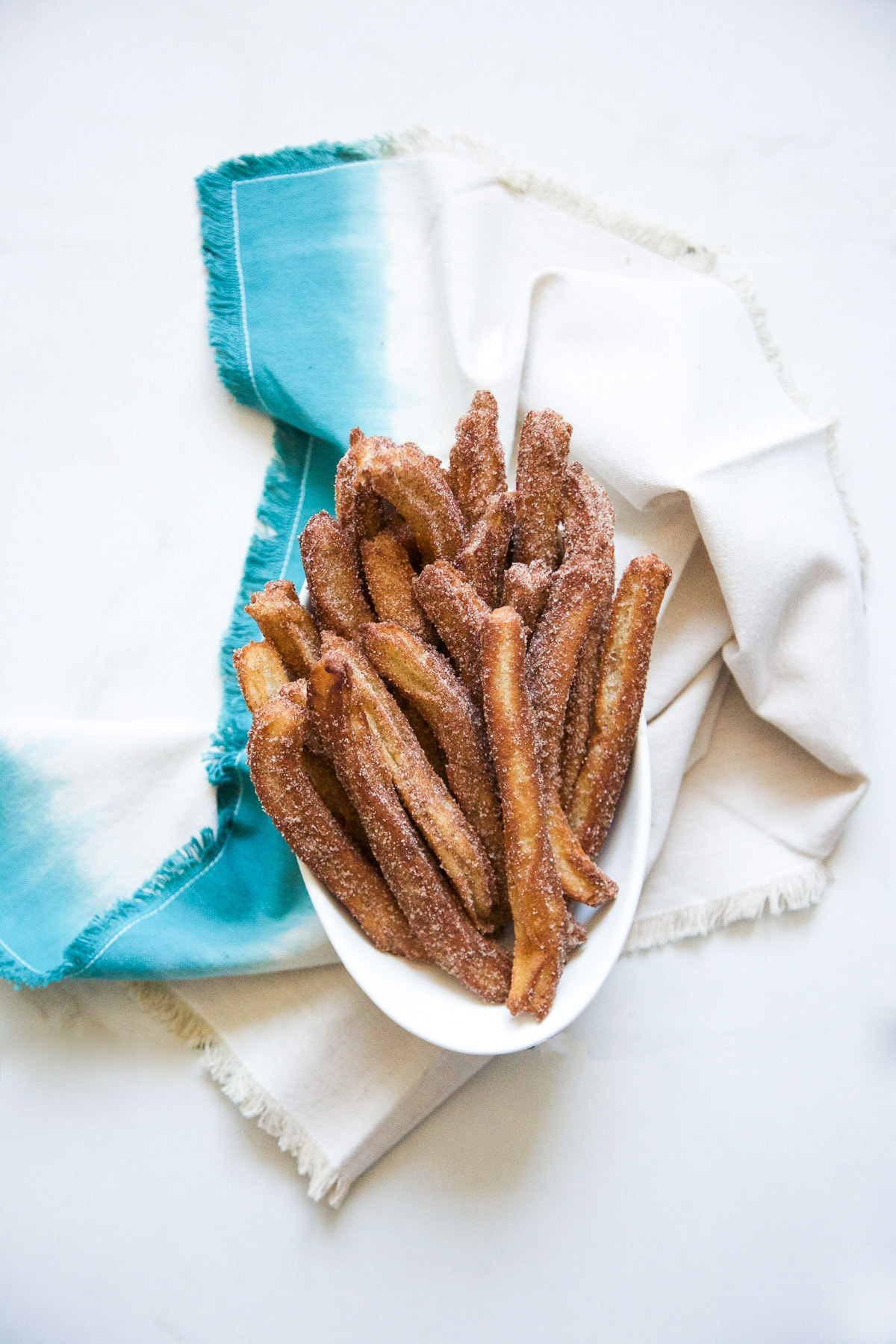 Cinnamon Churros with Chili Chocolate by Sugar & Cloth, an award winning DIY, recipes, and home decor blog.