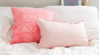DIY Pink Shibori Throw Pillow by Sugar & Cloth, an award winning DIY and home decor blog.
