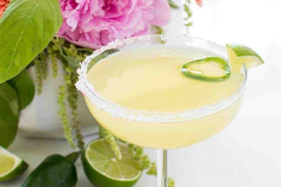 photo of a garnished skinny margarita recipe with salt by sugar and cloth