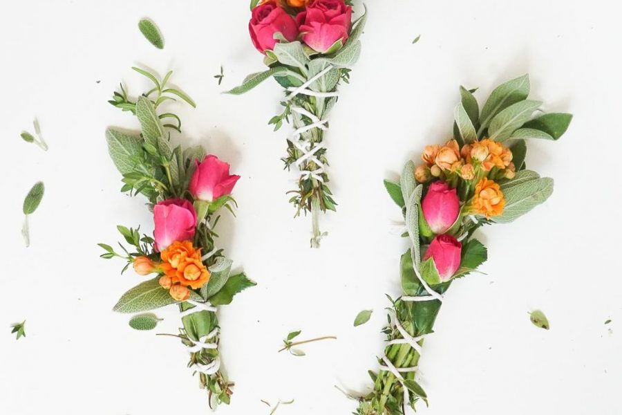 a photo of 3 sage bundles with flowers and scissors