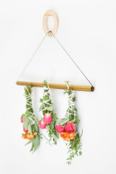 a side photo of how to dry sage bundles on a wall hanger