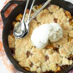 Skillet Peach Cobbler Recipe served with vanilla ice cream by Ashley Rose of Sugar & Cloth, a top lifestyle blog in Houston, Texas
