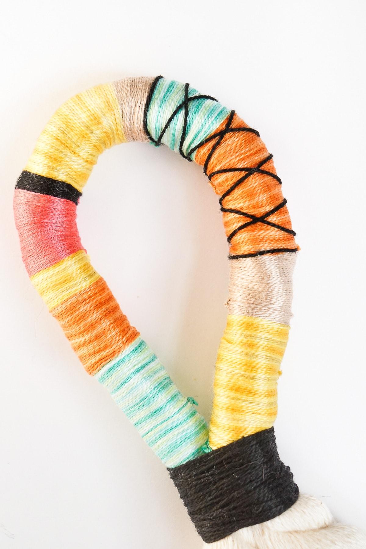 Step 5 -DIY Door Handle Tassels by Ashley Rose of Sugar & Cloth, a top lifestyle blog in Houston, Texas #DIY #door #tassels #fringe #colorful #doorhandle #homedecor #simple #rope #diyhomedecor