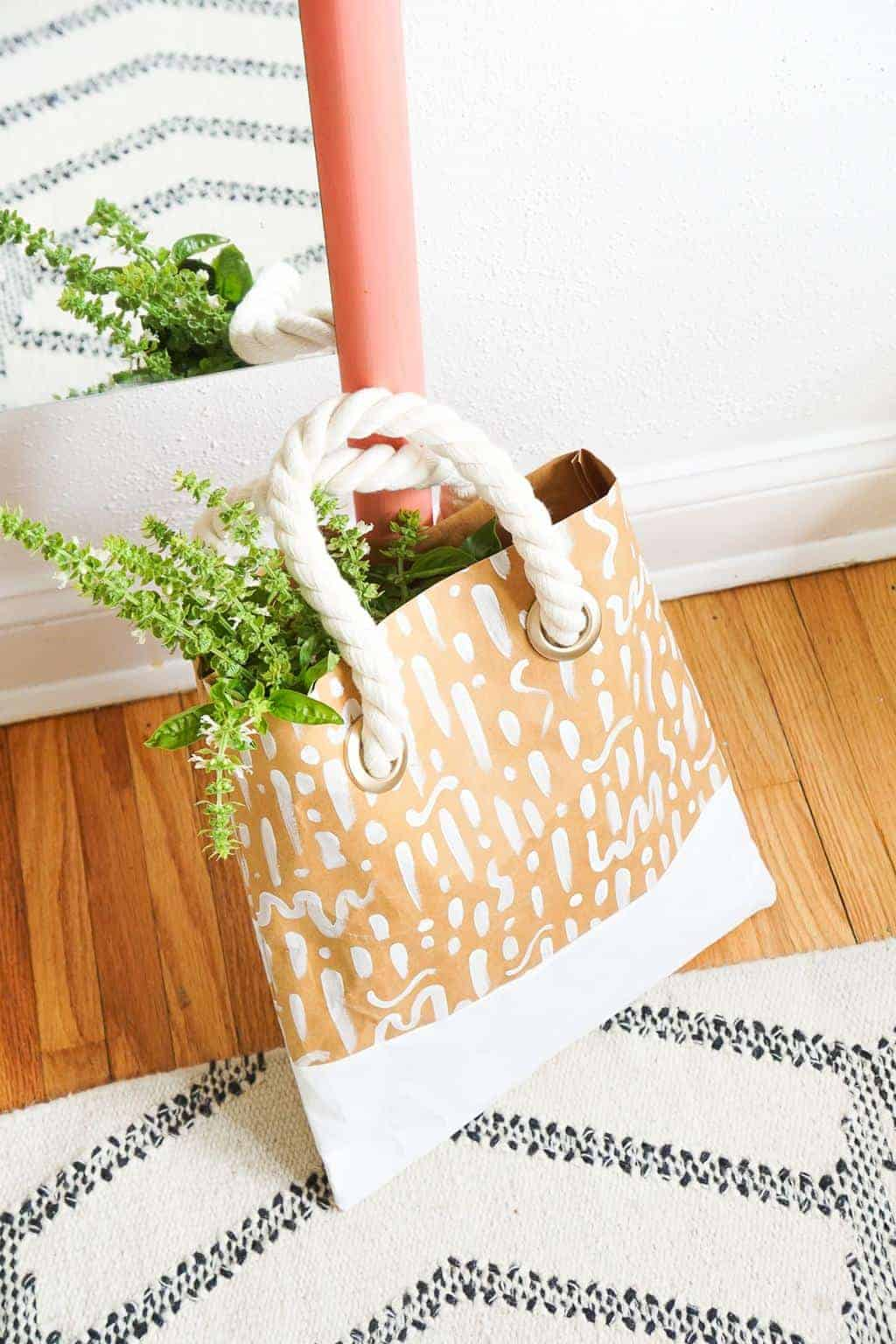 photo of a DIY Patterned Paper Tote made from paper on a rug