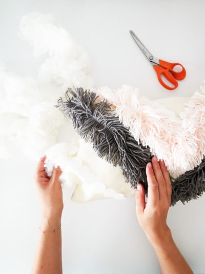 DIY Yarn Fringe Throw Pillow by Ashley Rose of Sugar & Cloth, a top lifestyle blog in Houston, Texas