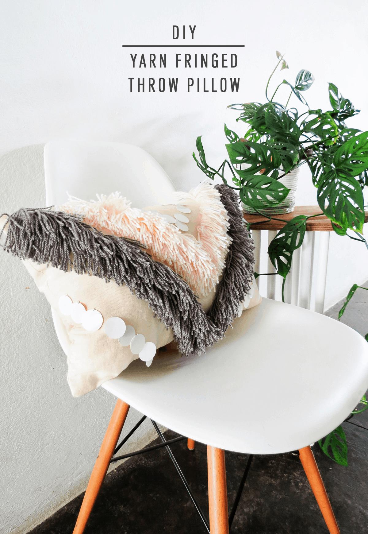 DIY Woven Yarn Fringe Throw Pillow by Ashley Rose of Sugar & Cloth, a top lifestyle blog in Houston, Texas