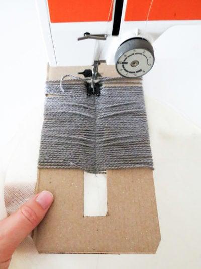 DIY Yarn Fringe Throw Pillow by Ashley Rose of Sugar & Cloth, a top lifestyle blog in Houston, Texas