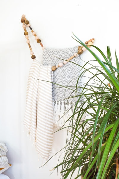 DIY Minimal Beaded Blanket Holder by top Houston lifestyle blogger Ashley Rose of Sugar and Cloth