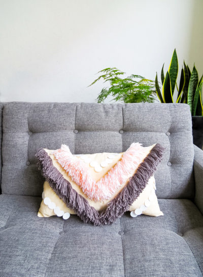 DIY Yarn Fringe Throw Pillow by top Houston lifestyle blogger Ashley Rose of Sugar and Cloth