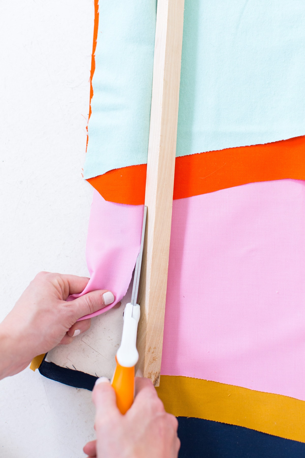 Colorful DIY Fabric Wall Hanging by top Houston lifestyle blogger Ashley Rose of Sugar and Cloth