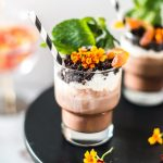 photo of edible flowers on a dirt dessert recipe with booze