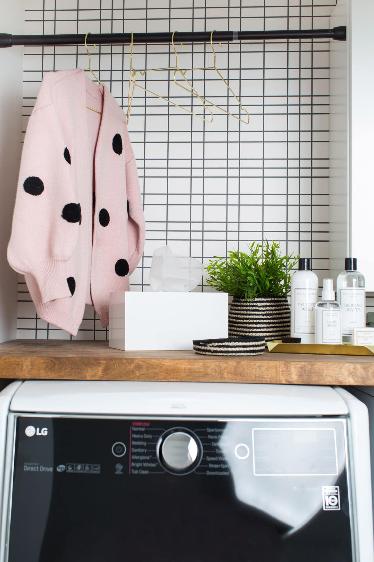 Big Reveal: Before & After of our Laundry Room Makeover + 2 Minute DIY Dryer Sheet Dispenser by top Houston lifestyle blogger Ashley Rose of Sugar & Cloth
