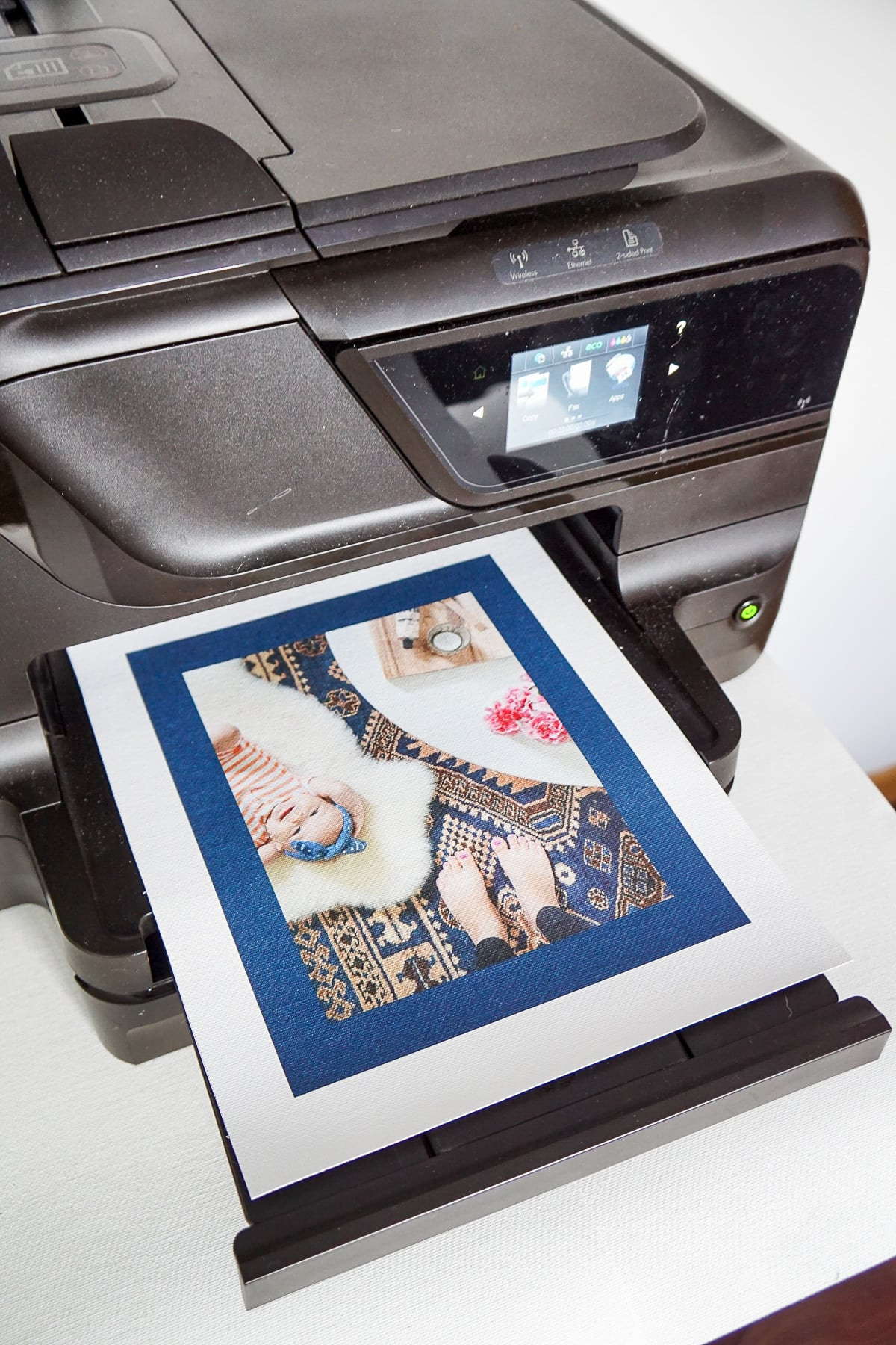 photo of the art print being printed out onto canvas paper by top Houston lifestyle blogger Ashley Rose of Sugar & Cloth