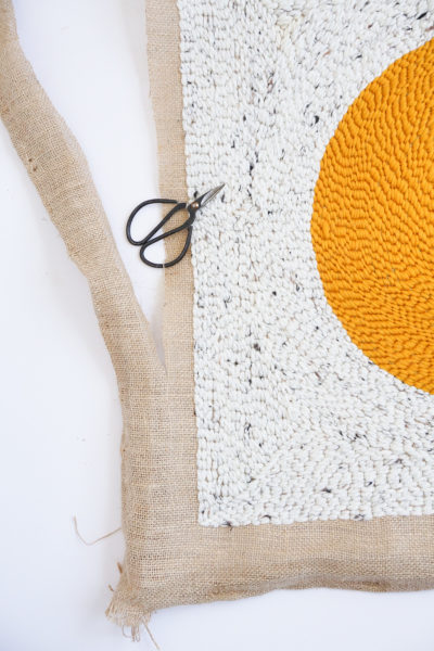 Step 9- DIY Rug Hook Pillow by top Houston lifestyle blogger Ashley Rose of Sugar and Cloth #rughook #diy #poillow #craft #diypillow #doityourself #pillowcase #homedecor #diydecor